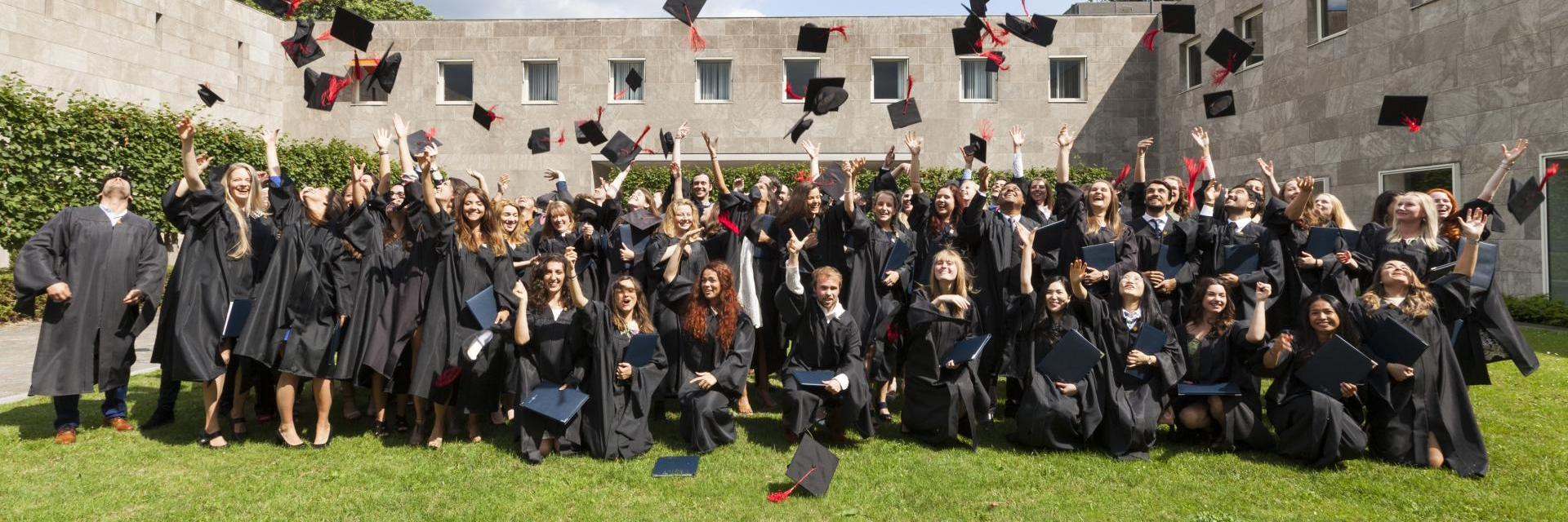 Master's students at their graduation ceremony
