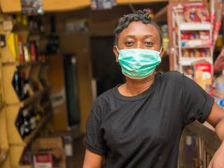 african shopkeeper with face mask